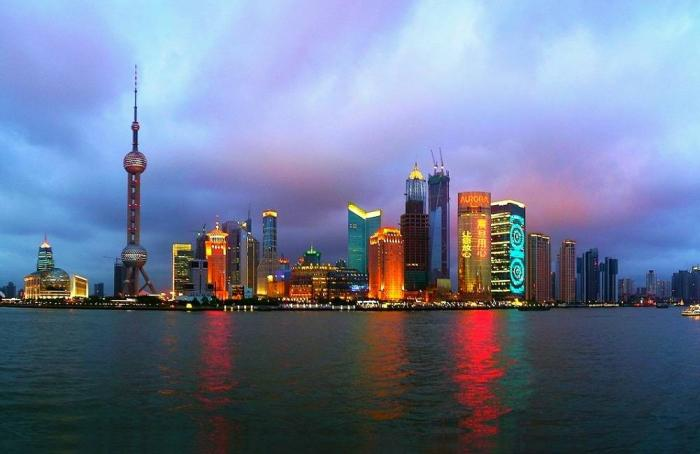 Shanghai city at night in China over the river