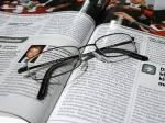 glasses and magazine pages