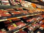 Meat on display in a grocery store.