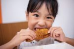 asian-little-girl-eating-fried-chicken.jpg