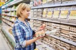 woman-choosing-packaged-eggs.jpg