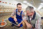 farmers-in-poultry-house-checking-technology