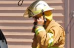 Firefighter-putting-mask-on