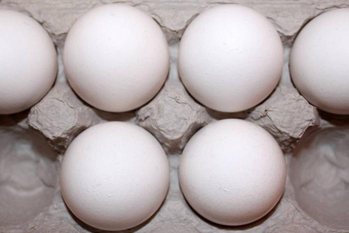 six white eggs in carton